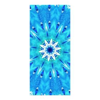 Plumas en el caleidoscopio del azul del trullo del plantilla de lona