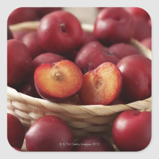 Plums in basket square sticker