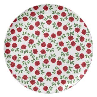 Poca placa roja de los rosas de té platos de comidas