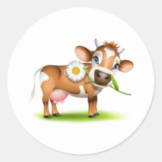 Poca vaca del jersey que come la margarita etiqueta redonda