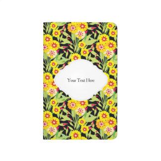Pocas floraciones del girasol del amarillo cuaderno grapado