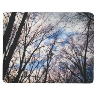 Pocket Journal with a Winter Forest and Cloudy Sky