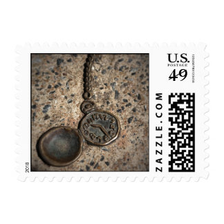 Pocket watch embedded in cement postage