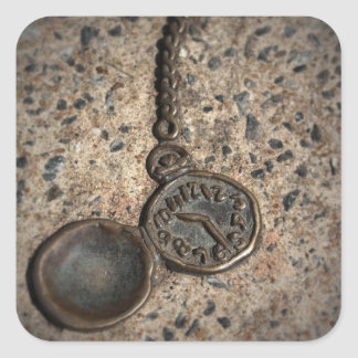Pocket watch embedded in cement square sticker
