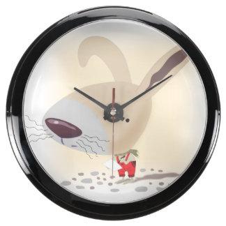 Poco conejito en pantalones rojos está escribiendo relojes aqua clock