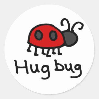 Poco insecto del abrazo etiqueta redonda