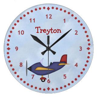 Poco reloj de pared azul del aeroplano