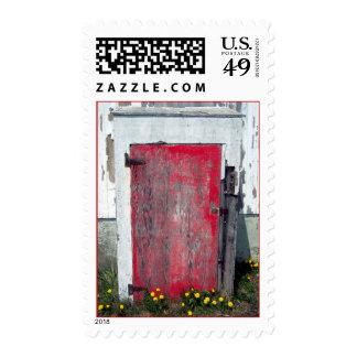 Poco sello rojo de la puerta