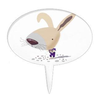 Pocos pantalones púrpuras del conejito están escri decoraciones de tartas