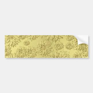 Poinsettias de oro del navidad en el papel de la h etiqueta de parachoque
