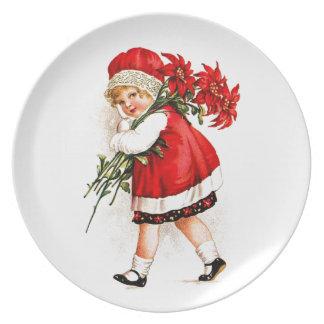 Poinsettias que llevan del chica del ejemplo del plato
