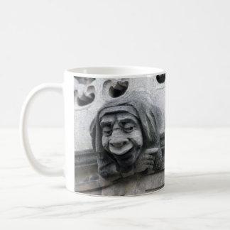 Pointing and face-pulling gargoyles mug
