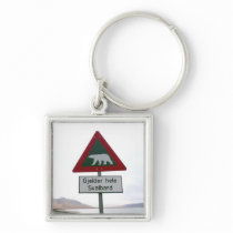 Polar bear crossing sign keychain