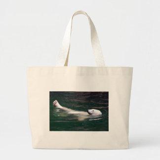 Polar bear just lazing bags