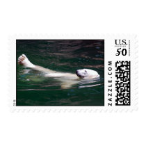 Polar bear just lazing postage