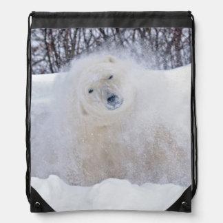 Polar bear shaking snow off on frozen tundra drawstring bag