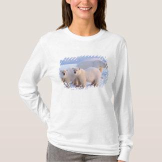 Polar bear sow with cubs on pack ice, coastal T-Shirt