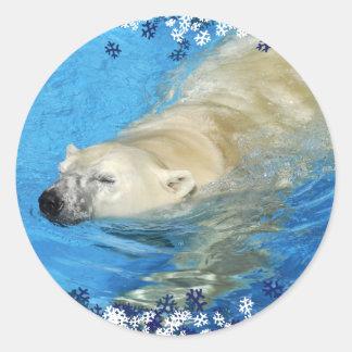 Polar bear swimming classic round sticker