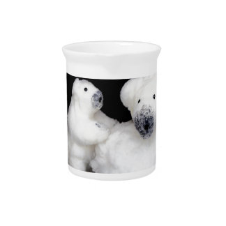 Polar bears family figurines playing with snowball drink pitcher