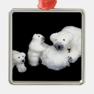 Polar bears family figurines playing with snowball metal ornament