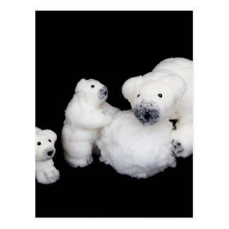 Polar bears family figurines playing with snowball postcard