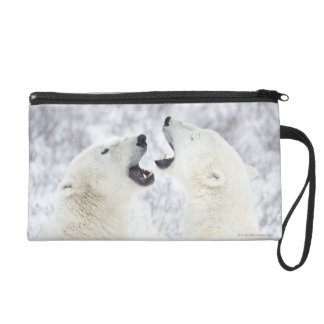 Polar Bears playing in the snow Wristlet Clutches
