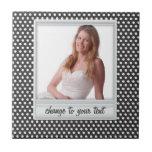 Polaroid photoframe on white & black polkadot ceramic tile