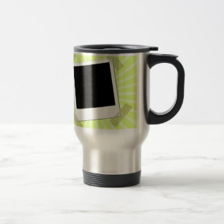 Polaroid taped on green background coffee mugs