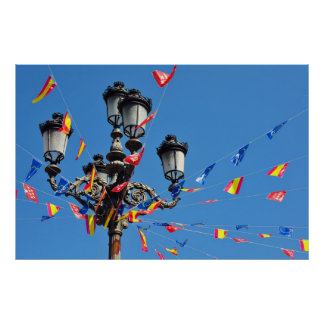 Pole with many flags against blue sky print