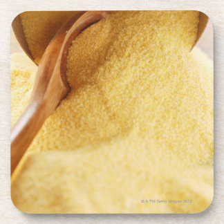 Polenta with wooden spoon and bowl beverage coaster