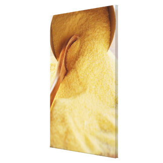 Polenta with wooden spoon and bowl canvas print