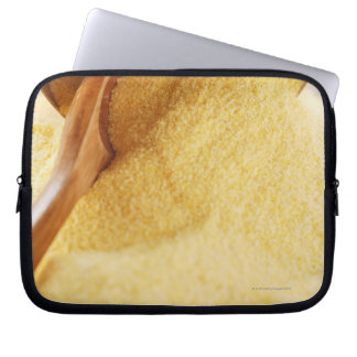 Polenta with wooden spoon and bowl computer sleeve