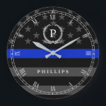 "Police Styled American Flag Monogram Large Clock<br><div class=""desc"">A wall clock featuring a thin blue line American flag symbolic of law-enforcement.  Roman numerals and a spot for yours or your gift recipient&#39;s Monogram and last name.</div>"