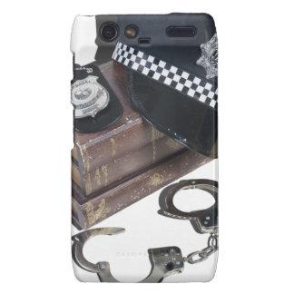 PoliceCrimeBooksHatBadgeHandcuffs042113.png Droid RAZR Case