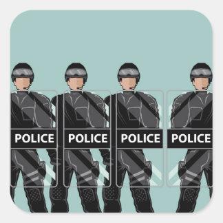 Policía antidisturbios con los escudos pegatina cuadrada