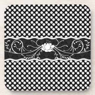 Polkadot blanco y negro y subió posavaso
