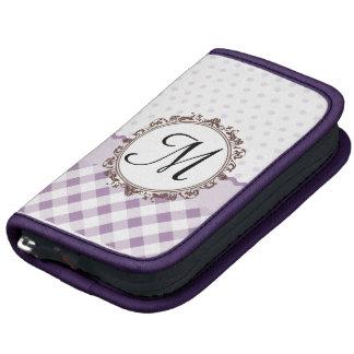 Polkadots púrpura, controles y rayas con el monogr planificadores