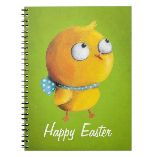 Pollo amarillo de Pascua con la cinta Libreta