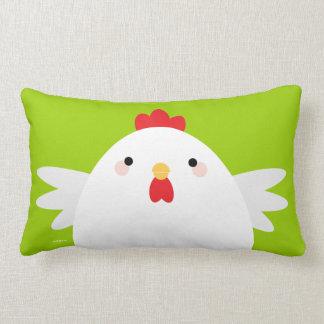 Pollo blanco en la almohada lumbar verde