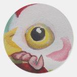 Pollo con un gusano pegatina redonda