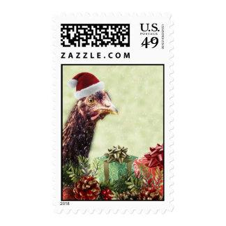 Pollo del día de fiesta del navidad en el gorra de franqueo