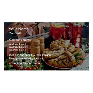 Pollo frito, flores del ponche de fruta tarjeta de visita