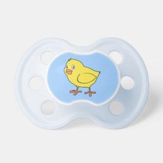 Polluelo amarillo feliz lindo chupete de bebé