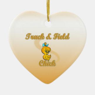 Polluelo del atletismo adorno navideño de cerámica en forma de corazón
