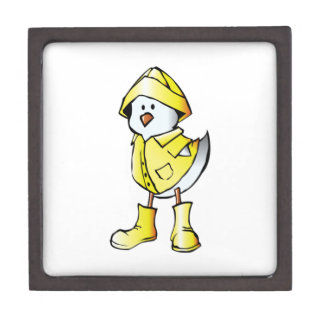 Polluelo del bebé del dibujo animado que lleva un caja de recuerdo de calidad