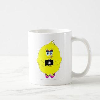 Polluelo del tecleo taza de café