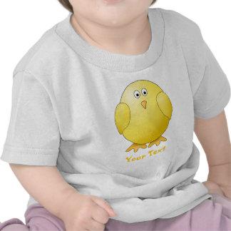 Polluelo lindo. Pequeño pájaro amarillo. Texto de Camisetas