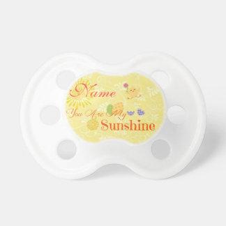 Polluelo y huevos de Pascua amarillos soleados Chupetes De Bebé
