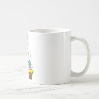 Polluelo y huevos taza de café