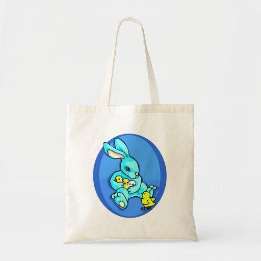 polluelos azules del conejo tres que sostienen un  bolsas lienzo